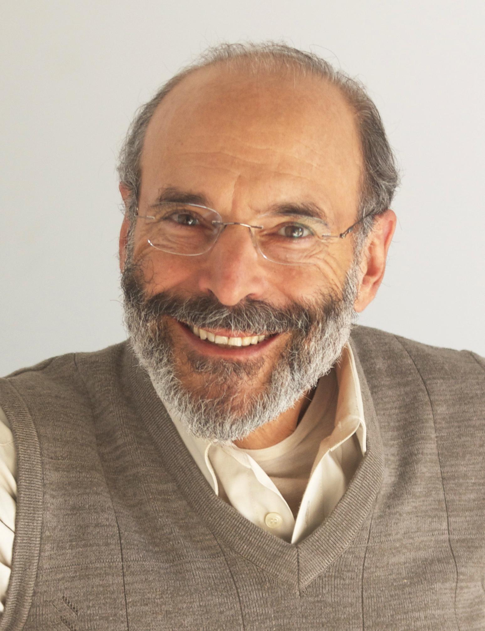 Dr. Alan M. Dattner